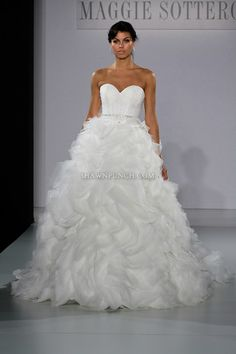 Model walks runway in a Jerrica wedding dress from the Sottero and Midgley Spring 2013 collection, at The Couture Show, during New York Bridal Fashion Week, on October 14, 2012.