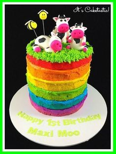 """""""Naked"""" rainbow cakes have become one of my most popular cakes.  Rather than covering the whole cake with icing to hide the surprise of the colours I make a feature of the rainbow shades by using matching icing.  This cake was made with butter cake and Swiss meringue buttercream.  The cows and bees were made from fondant and the grass was piped using the Wilton grass tip."""