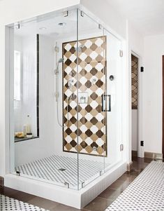 Add a seat beneath a window so you can enjoy natural light, views, and, in this case, comfortable proximity to handheld sprays. This high-style walk-in shower houses a tiled window alcove that boasts a marble-capped seat. #showerremodel #showerbenchideas #bathroomideas #walkinshower #bhg Small Bathroom With Shower, Small Showers, Small Bathrooms, Bathroom Ideas, Bath Ideas, Bathroom Remodeling, Handicap Bathroom, Narrow Bathroom, Shower Bathroom