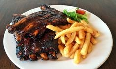 Groupon - 500g Pork Spare Ribs with Chips and Onion Rings from R110 at Lighthouse Pub and Grill (Up to 55% Off) in Cape Town. Groupon deal price: R110