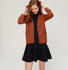 This pumpkin-colored V-neck cardigan plays on menswear styling, slimmed down for a feminine finish. Ribbed placket, pockets, cuffs and hem. V Neck Cardigan, Cotton Cardigan, Open Cardigan, Sweater Cardigan, Cute Cardigans, Cardigan Sweaters For Women, Orange Sweaters, How To Slim Down, Business Attire