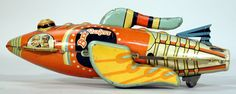 """This Patrol Ship spaceship toy from 1934 was merchandise for Buck Rogers, the popular space-based adventure series. This toy represents the main character's own ship. According to advertisements from 1934, winding this Louis Marx action toy allowed its owner to imagine traveling """"through the inter-planetary void in a miniature model of Buck Rogers' famous Rocket Ship."""""""