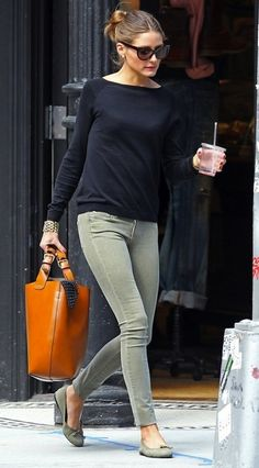 Olive jeans, black knit sweater, tangerine bag