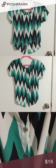 Chevron shirt Cute black, white and green chevron shirt. It's longer in the back with gold buttons going down the back. a'gaci Tops Blouses