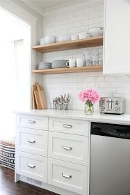 Pretty kitchen redo. Quartz countertop. I like the open shelves, maybe in the butlers pantry instead of a cabinet?