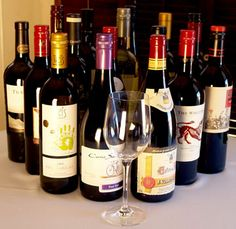 16 Best Wines under $ 15 - from Men's Health.  It also tells you what food to have with the wine!