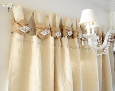 Burlap Curtains- Tea dyed rosettes- Wide Tabs  Thank you for stopping by my rustic and chic shop!  ....Burlap, what a simple and natural fabric that will highlight your dining room, bedroom or sunroom! You can also adorn these in your patio!  Simple, ecogreen....with a romantic touch... A tea dyed fabric rosette...  Made in a smoke free environment ...from my hand to yours....  We can talk about your special order...just convo me.  Listing price is for ONE PANEL and that includes: 35 across…