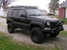 GETTING IDEAS: I like the bumper, lift, tires, fog lights and roof lights on this one...