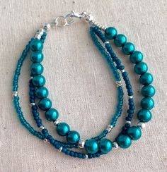 A personal favorite from my Etsy shop https://www.etsy.com/listing/255106408/teal-bracelet-teal-and-silver-bracelet