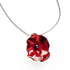 Hand-forged in enamel-coated sterling silver and featuring a cultured pearl center, the pendant on the Flower #Necklace plays off the unique folds and waves of a springtime bloom.