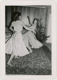 The gallery of mid-century women enjoying fake Christmas trees is glorious. But if all that aluminum leaves you hankering for the look of real pine, we've got pictures for that, too. Real Christmas Tree, New York Christmas, Christmas Mood, Retro Christmas, Xmas Tree, Christmas Stuff, White Christmas, Christmas Cards, Vintage Christmas Photos