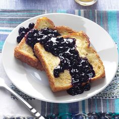 "Baked French Toast with Blueberry Sauce Recipe -The sponge-like nature of French toast gives it that ""special occasion"" feel, though why hold it back when it's one of the easiest ways to get egg and bread together in the morning? Bring it on with a tangy blueberry sauce. —Debbie Johnson, Centertown, Missouri"