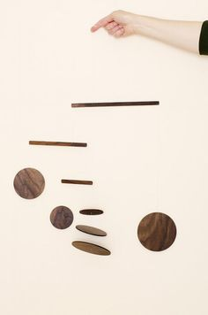 Handmade wooden walnut mobile from Frazier and Wing
