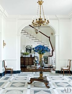 The classic entrance hall of a Houston mansion decorated by Cullman & Kravis.