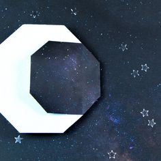 Learn to fold an origami crescent moon from one sheet of paper. This origami moon makes a great addition to space themed artworks or night-time collages! Origami Rocket, Origami For Kids Animals, Hanging Origami, Sailor Moon Dress, Paper Art, Paper Crafts, Origami Models, Oragami, Pencil Boxes