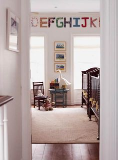 Simple decorating allows for easy adaption to a child's playroom. Side-by-side cribs are comforting for twins.