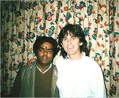 George Harrison poses with an Indian musician in 1989 during the sessions for 'Armchair Theatre'.