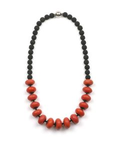 Beautiful necklace named Avatar. It is made of large antique orange and black lava beads. Necklace Avatar is handcrafted by Marion Pannekoek | The Jewelry Story The Netherlands