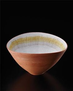 Lucie Rie: Oval bowl, Earthenware, unglazed exterior, white well with painted manganese lines crossing a yellow band. 3 in. (7.6 cm.) high, c.1947