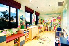 Designer: Robinette Architects, Inc., Tucson, AZ A cheerful custom wall mural in a child's playroom, with a bold landscape of colorful flowers and leaves. The mural surrounds the room, offering a bright, positive environment, ready for both learning and play.