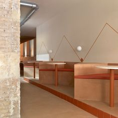 Wood and terracotta contrast rough exposed brick and terrazzo table tops inside BeGood salad bar, Valencia