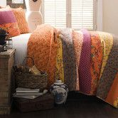 $74.99 in Full/Queen (88W x 92L) &  $79.99 in King (108W x 92L), both sets include quilt & 2std shams, in Tangerine, plum and Peacock (blue), buy 1 Full/Queen for bed and 2 Kings to make curtains & accessories out of (no others available online).  Found it at Wayfair - Royal Empire 3 Piece Quilt Set