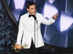 """Rami Malek accepted his Outstanding Lead Actor award in a drama series for """"Mr. Robot"""" in a white Dior Homme Tuxedo Jacket."""