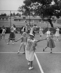 Tennis veteran Florene Sutton shows the correct forehand motion to school children at a weekly clinic in Tennis Rules, Tennis Tips, Tennis Gear, Tennis Techniques, How To Play Tennis, Tennis Pictures, Wall Pictures, Tennis Serve, Tennis Lessons