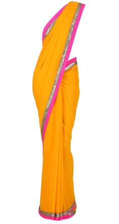 Mango yellow georgette Sari with shocking pink and shine border with golu's by MANISH MALHOTRA. Shop at https://www.perniaspopupshop.com/whats-new/manish-malhotra-3463
