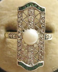 1930s Art Deco emerald, diamond, and pearl ring set in platinum.