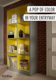 Spice up your entryway with a simple bookshelf, collected home decor pieces, and your favorite bold shade of BEHR paint—like Laser Lemon! Click for even more style inspiration ideas.