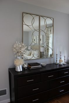 I like the mix of soft traditional/ vintage and the hard clean lines of the modern dresser