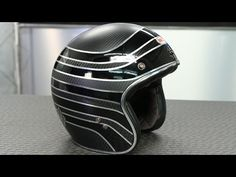 Carbon fiber is the key word for Bell in 2015. As you can imagine the Bell Custom 500 Carbon RSD Talladega Helmet is constructed out of it and it comes in at...