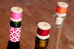 #DIY Thread Spool Wine Corks - Such a cute addition to your wine bottles! Use this as decor or as an extra, decorative touch to wine served at a get-together.
