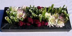 Flower arrangment autumn with dahlias in polygonum sticks or branches Funeral Flower Arrangements, Modern Flower Arrangements, Funeral Flowers, Wedding Flowers, Deco Floral, Floral Design, Sogetsu Ikebana, Japanese Flowers, Flower Boxes