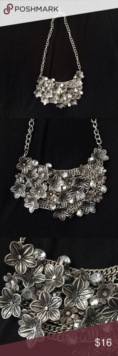 Floral Bib Necklace Silver embellished necklace with flowers and clear rhinestones. Lovely piece to add to your wardrobe. Francesca's Collections Jewelry Necklaces