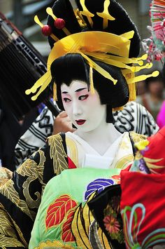 Oiran (花魁) - Oiran were the highest class of courtesans in Edo (now known as Tokyo). An oiran was valued not only for her beauty and charm, but also her wit, knowledge, and skill in traditional Japanese arts. Their dress often consisted of layers of ornate kimono and extremely elaborate hairstyles, with one distinguishing feature being an obi tied at the front of the body rather than at the back. Though there are no longer any oiran left in Japan because of laws.