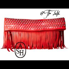 """% Authentic ASH, Red Fringe Clutch with Studs Soft beautiful red leather, and a dash of silver studded flash, is the highlight of this clutch.  A new and popular brand, from France.  If you are looking for class, and want to stand out, this is the clutch for you!  Brand new, with tags.  Comes with the all original, never used, dust cover.  Unavailable in the US.  (Prices firm, no pay pal, or trades).     Dimensions: Bottom Width 13.5"""", Depth: .25"""", Height: 7.25"""", Weight: 1.32 lbs. Ash…"""