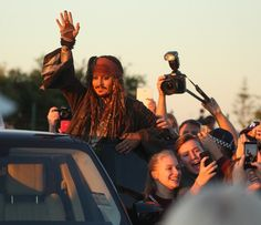 Ahoy, Mateys! Johnny Depp waved to fans — dressed as Captain Jack Sparrow — while filming the new Pirates of the Caribbean movie in Australia on June 2.