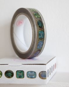 I would use this....really! It's jewel packing tape. Imagine getting a box wrapped with this.