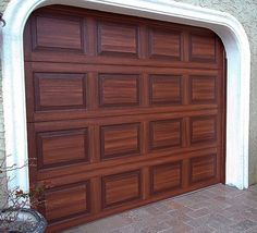Be sure to check out the faux wood doors if you are shopping for new garage doors. A more expensive option is to install a faux wood garage door. Garage…Read more of Faux Painting Garage Doors Garage Door Update, Faux Wood Garage Door, Metal Garage Doors, Garage Door Paint, Garage Door Colors, Modern Garage Doors, Garage Door Makeover, Metal Garages, Garage Door Design