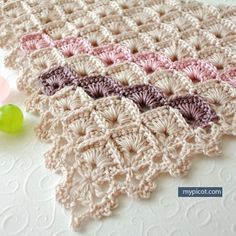 What a gorgeous looking stitch pattern for a beautiful prayer shawl or maybe for a stunning baby blanket! Triangle Shawl Box Stitch Pattern by MyPicot comes with a diagram and step by step instructions. Directions given on the pattern's page recommend using a soft yarn and the size of hook larger than the size that