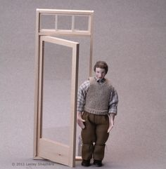 This easy to make shop door in dolls house or model scale will fit a range of traditional and modern shops.