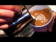 Barista shows how to make latte art :) Fun and easy to learn, must watch!!