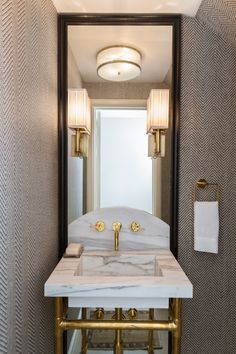 Marie Flanigan Interiors - beautifully appointed gray and brass powder room.