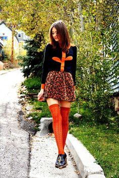 Orange is such an under-appreciated color and I love how its various shades are on display in the sweater, floral skirt, and textured socks.