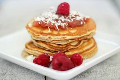 Protein Pancakes with fresh raspberries, sugar free jam and a sprinkle of shredded coconut!  #cakeporn #proteinpancake #lowcarb #protein #fitfoodie #fitspo #fitfood #fitness #postworkout #breakfast #healthysnack #healthyfat