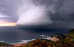 A squall line associated with a thunderstorm over Era Beach, south of Sydney by photographer Bruce Cooper