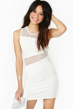 Lost In The Light Dress: White hot body-con dress featuring a scoop neckline and asymmetric sheer mesh panels. Exposed zip closure at back, stretch fabric. Unlined. Looks killer with stacked bangles and platform boots!
