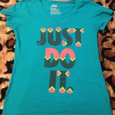 Just do it Nike shirt Super cute. Vibrant colors. Only flaw there is a slight hole in the back near the sewing but it's not that noticeable. Nike Tops Tees - Short Sleeve